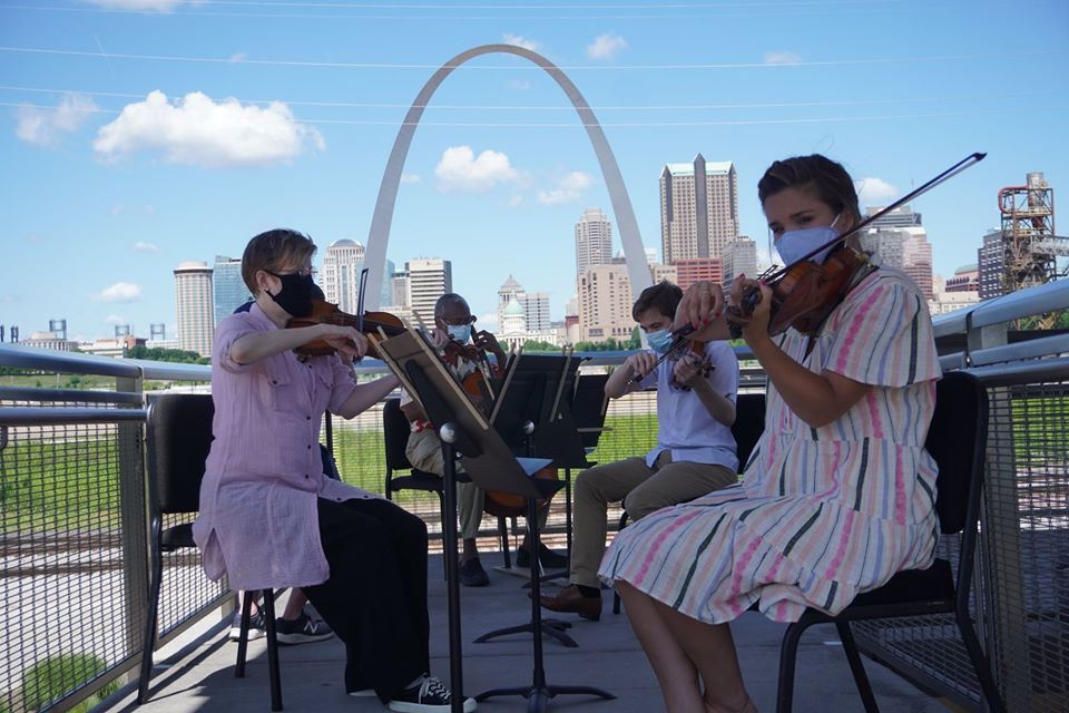 St. Louis Symphony Orchestra musicians play with the Arch in the background