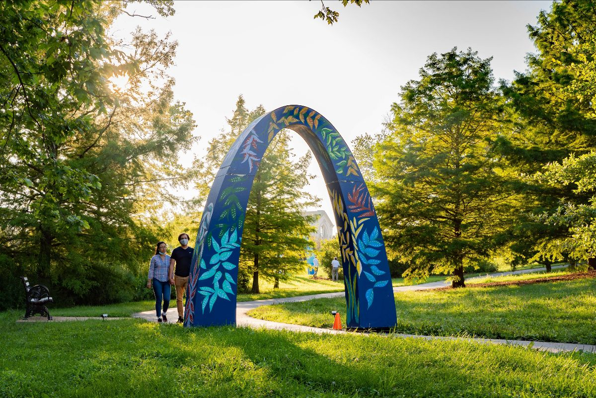 A Late Summer Night's Stroll in Forest Park. Arch # 2 designed by artist Eugenia Alexander. Photo by Phillip Hamer Photography.