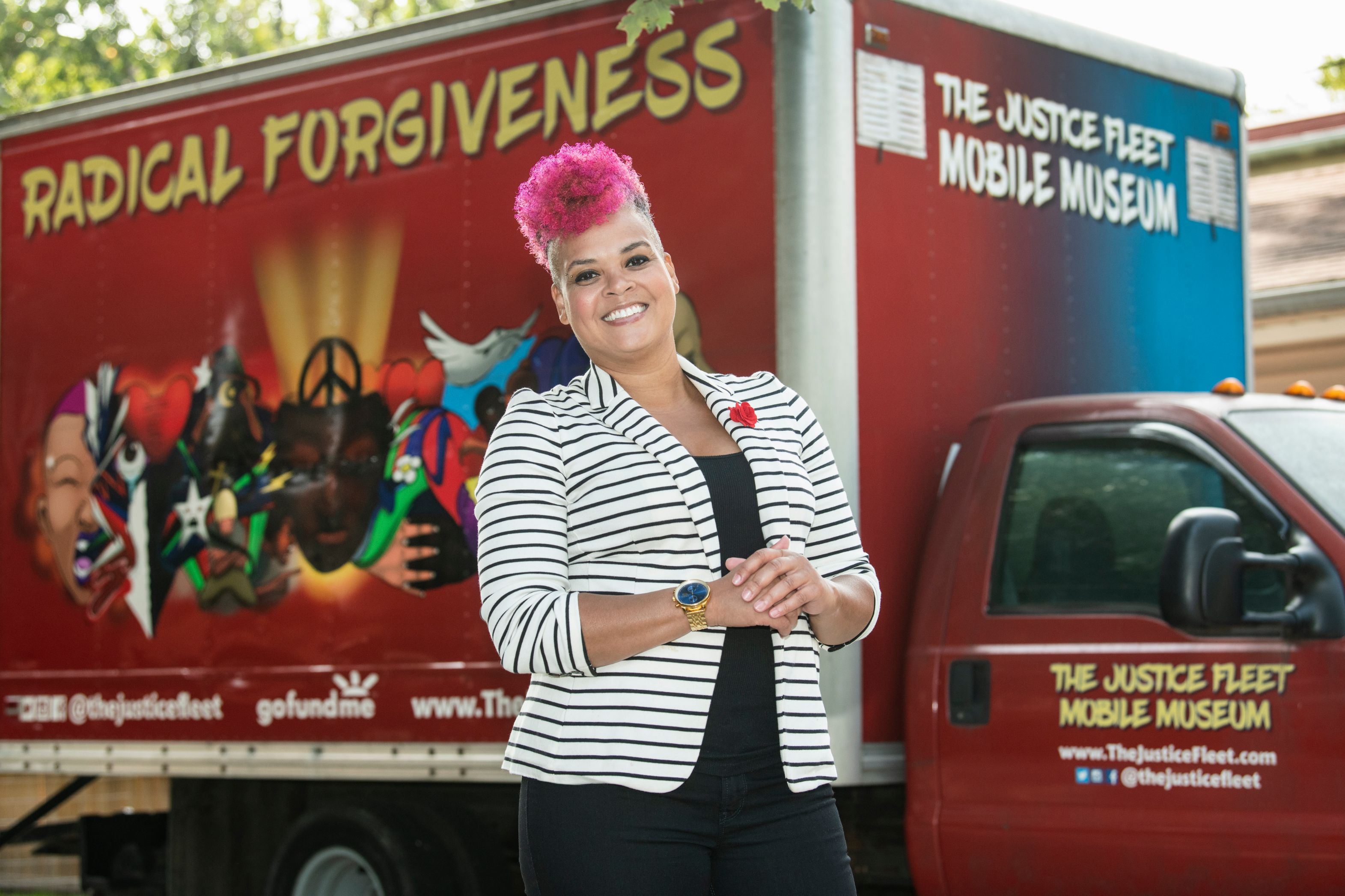 Amber Johnson stands in front of the Justice Fleet Mobile Museum