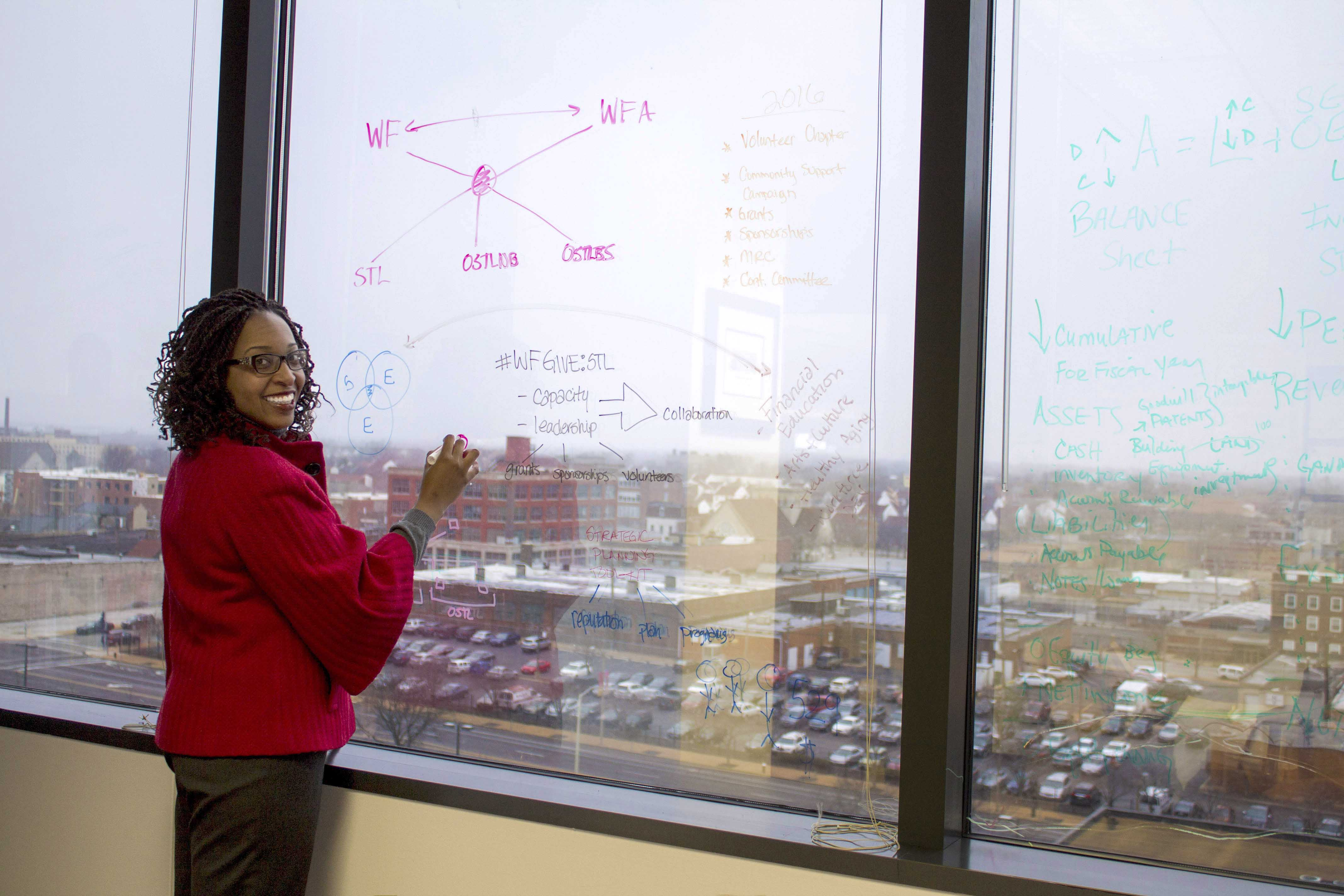 Cooksey at her office window overlooking the city.