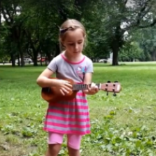 Photo of child playing instrument at summer art camp